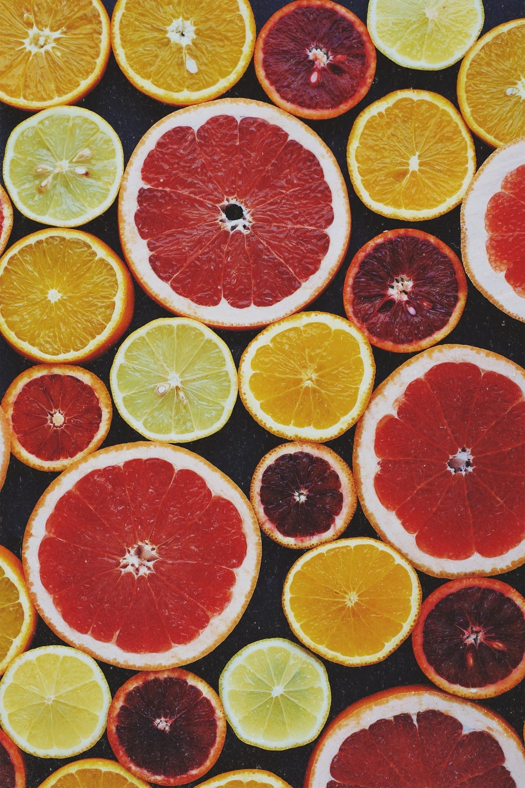 top-view-photo-of-sliced-citrus-fruits