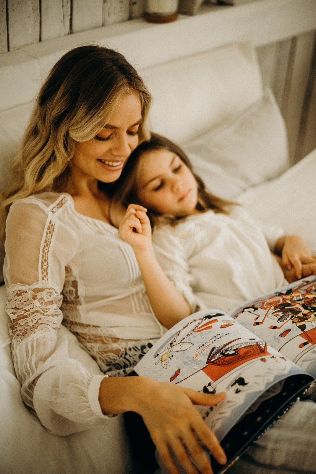 woman-and-child-in-bed-reading-magazine