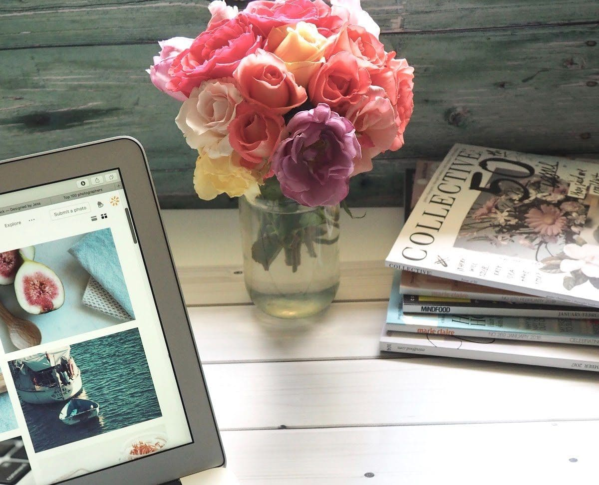 laptop-flower-bouquet-and-magazines-on-white-table