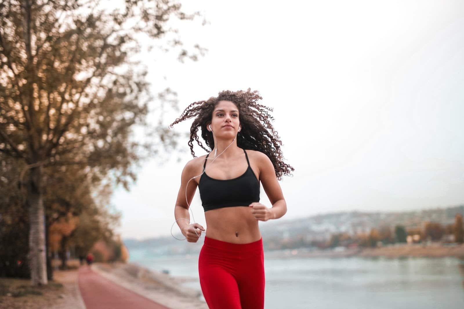 woman-in-black-sports-bra-running