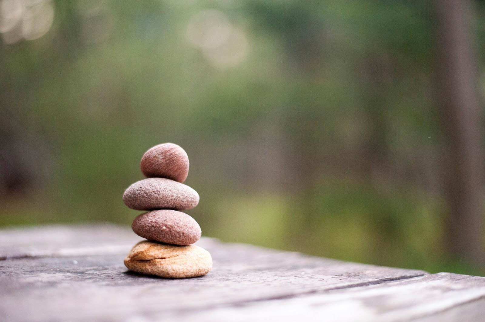 four-small-flat-rocks-balanced-in-a-stack