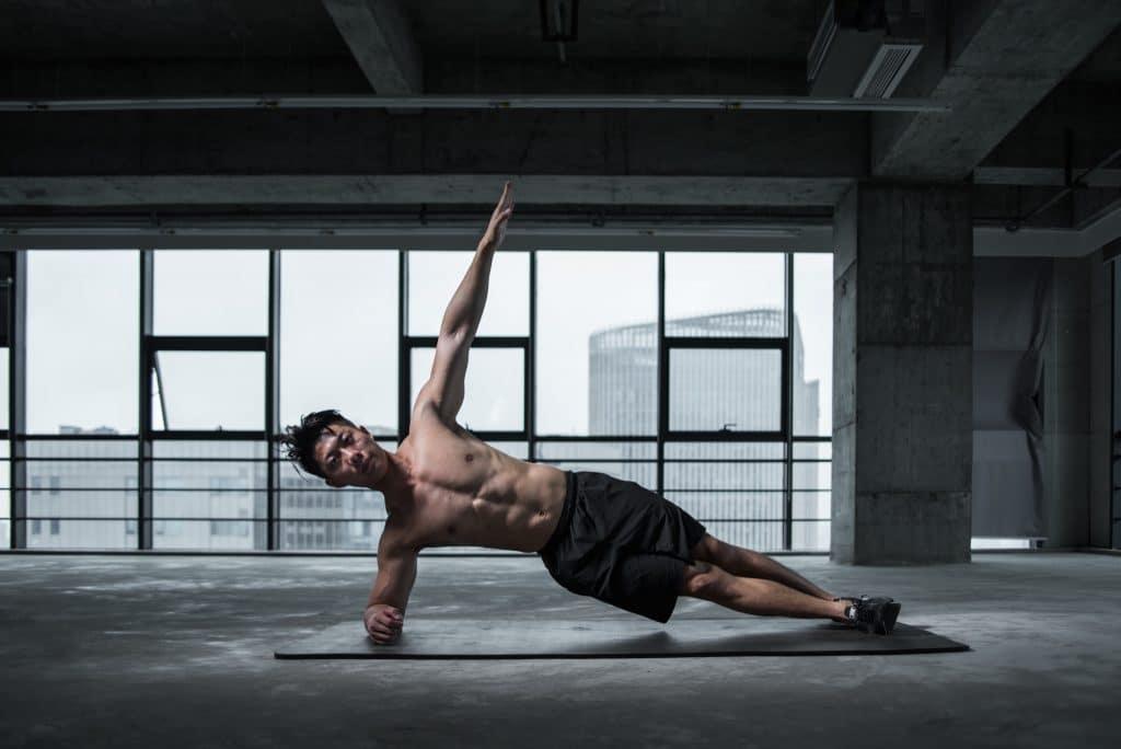 athletic-man-doing-yoga-stretch