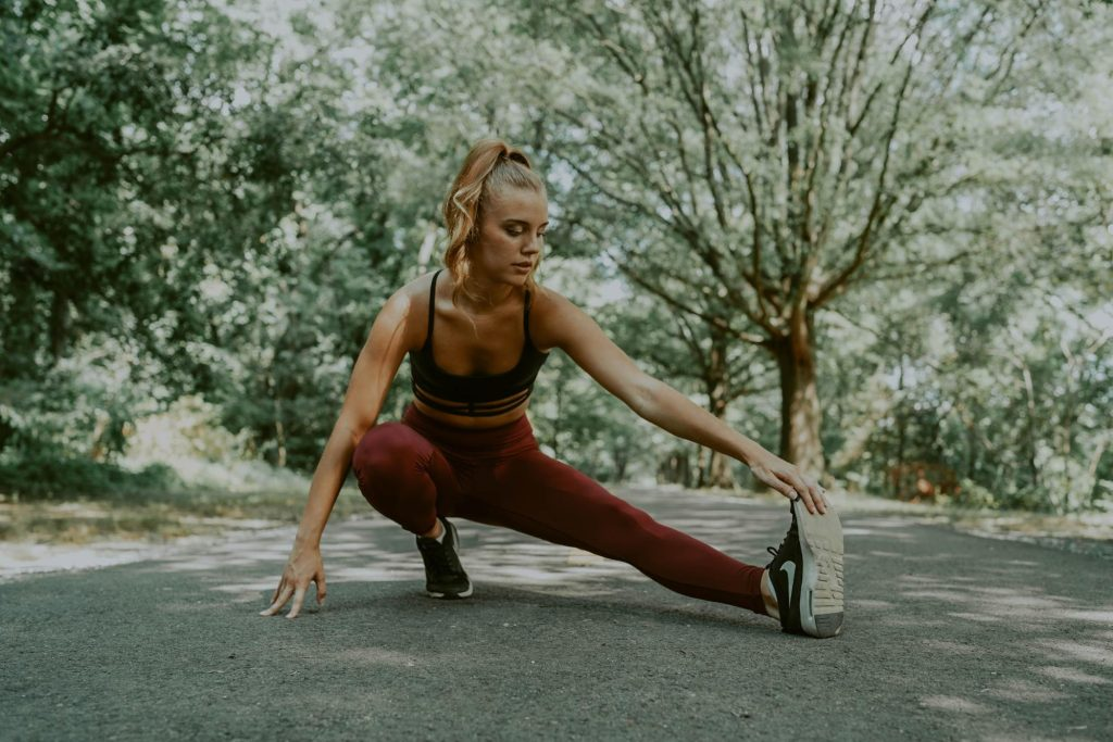 Prebiotics have been shown to help with weight loss. In this image a woman stretches before exercising.