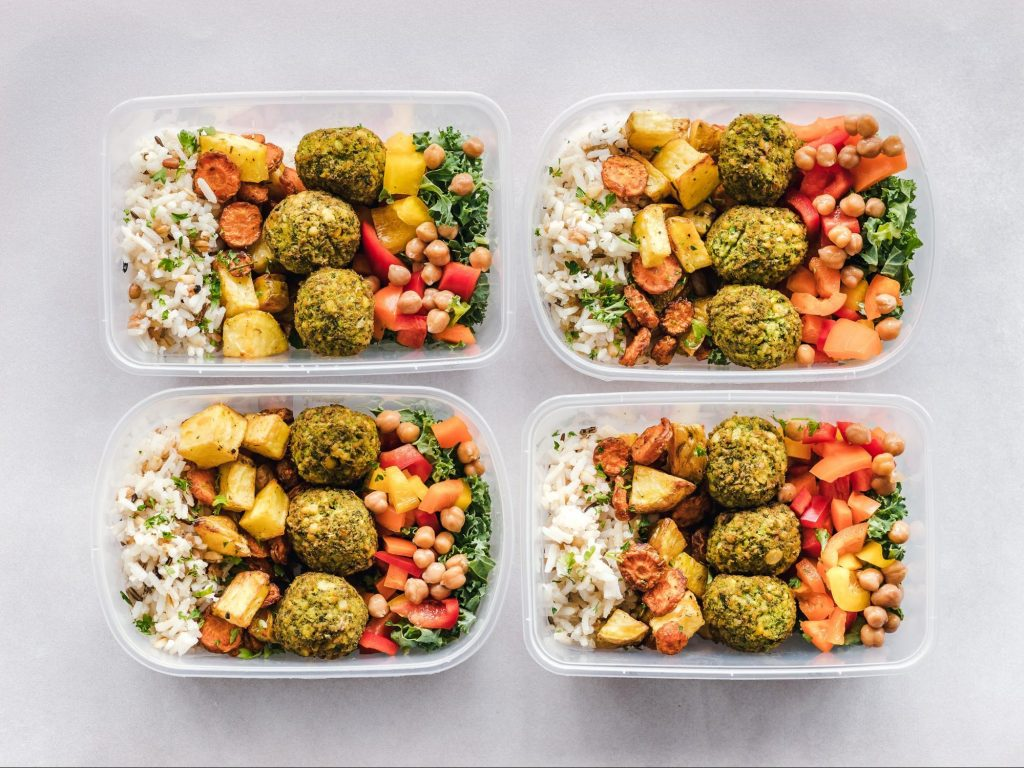 Healthy prebiotic filled meal prep lunches viewed from above.