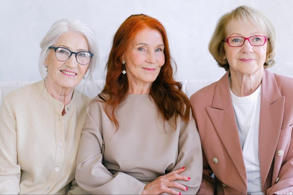 Three senior ladies smiling at the camera. Probiotics can help seniors stay regular and avoid constipation.