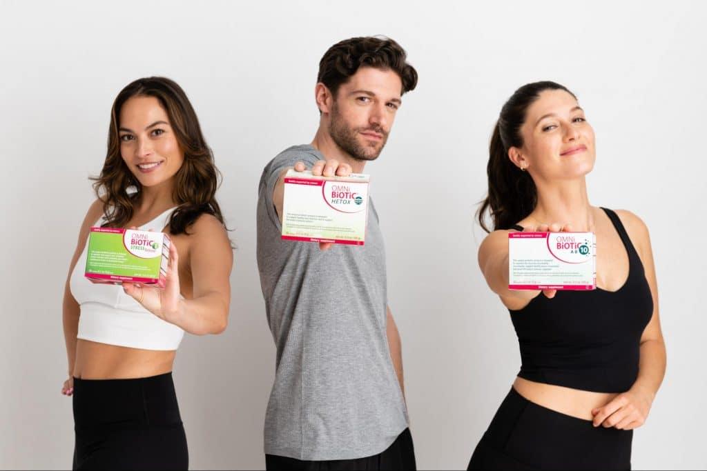 Healthy people holding omni biotic probiotics.