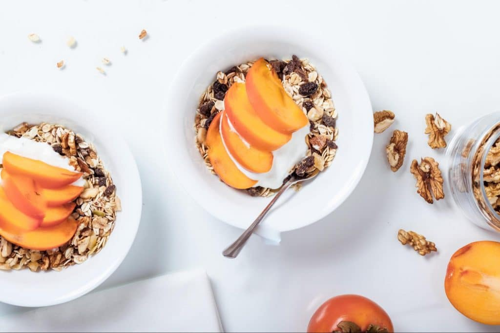 Healthy yogurt snack with granola and peaches.