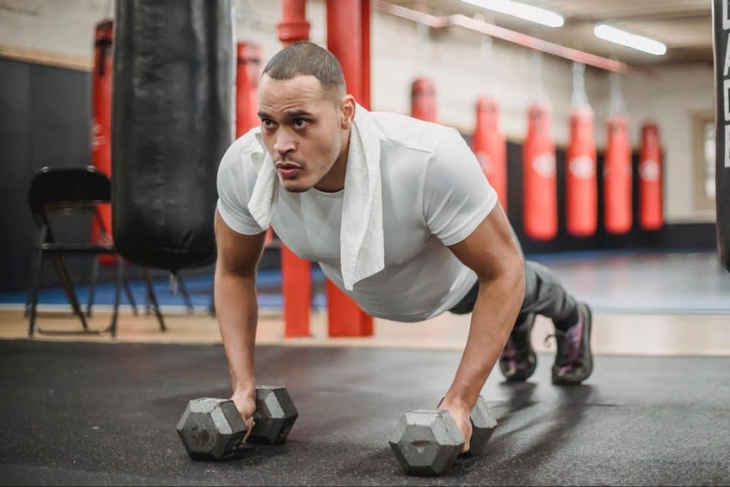 Man doing push ups at the gym.