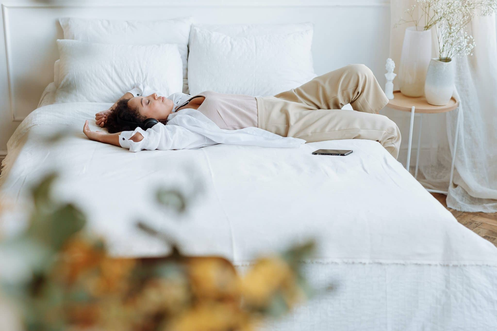 Woman lying on bed resting