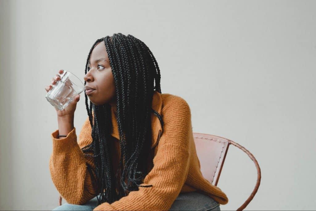 black woman drinking water