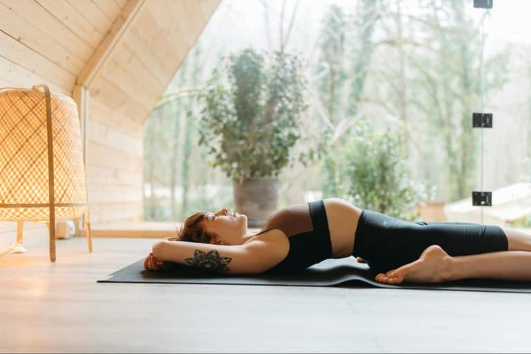woman doing yoga in well lit room
